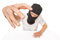 Man in black mask tries to grab the viewer on white background Stock Photography
