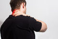Man in black t shirt holding her painful neck, back, experienci