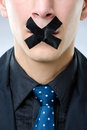 Man with black tape over his mouth Royalty Free Stock Photos
