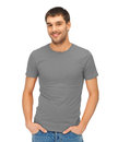 Man in blank grey t shirt clothing design concept handsome Stock Image