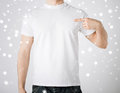 Man in blank t shirt advertisement and design concept pointing at himself Stock Photos