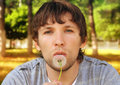 Man blowing Dandelion Royalty Free Stock Photography
