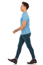 Man in blue shirt walking in isolated studio background Royalty Free Stock Photo