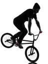 Man bmx acrobatic figure silhouette one caucasian exercising in studio isolated on white background Stock Photos