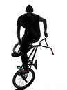Man bmx acrobatic figure silhouette one caucasian exercising in studio isolated on white background Royalty Free Stock Images