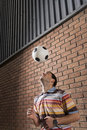 Man Bouncing Ball Off Head In Portico Royalty Free Stock Photo