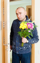 Man with bouquet asks forgiveness of flowers Royalty Free Stock Photography