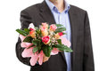 Man with bouquet of flowers in suit holding for apology Stock Photo
