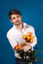 Man with bouquet of red roses on blue background Royalty Free Stock Image