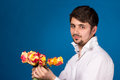 Man with bouquet of red roses on blue background Royalty Free Stock Images