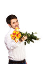 Man with bouquet of red roses isolated on white Royalty Free Stock Photography