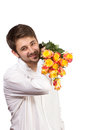 Man with bouquet of red roses isolated on white Royalty Free Stock Photo