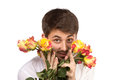 Man with bouquet of red roses isolated on white Royalty Free Stock Image