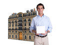 Man box and parisian building young holding a blank with a at the background Stock Photo