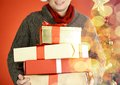 Man with boxes close up of stack of giftboxes Royalty Free Stock Photography