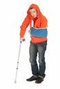 Man with broken hand walking on crutch Royalty Free Stock Image