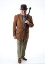 Man in brown jacket and derby holding black briar walking stick
