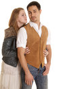 Man in brown vest looking woman behind him Stock Photo