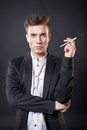 Man with a brush stylish young handsome in suit Royalty Free Stock Photos