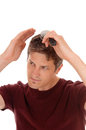 Man brushing his hair. Royalty Free Stock Photo