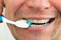 Man brushing teeth close up photo of a Stock Image