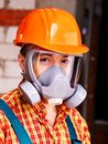Man in builder respirator. Royalty Free Stock Photo