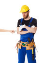 Man builder in the uniform and white gloves Royalty Free Stock Photo