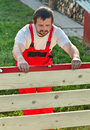 Man building new wooden fence Royalty Free Stock Photo