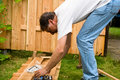 Man are  building a wooden fence Royalty Free Stock Photo