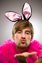 Man in bunny ears blowing kiss Royalty Free Stock Photo