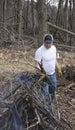 Man buring brush burning in the woods Royalty Free Stock Photos