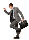 Man in a business suit with suitcase isolated Stock Photography