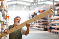 Man buying construction wood in a diy store for his home re modeling project Stock Photos