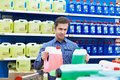 Man buys windshield washer fluid in shop Royalty Free Stock Photo