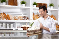 The man with cakes Royalty Free Stock Photography