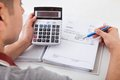 Man calculating financial expenses at home Royalty Free Stock Photo