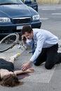 Man calling an ambulance for injured woman Royalty Free Stock Photo