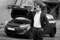 Man calling in technical service to evacuate broken car black and white portrait of Stock Images