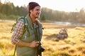 Man with camera in countryside, Big Bear, California, USA Royalty Free Stock Photo