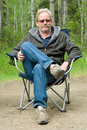Man in Camping Chair Outside Royalty Free Stock Photo
