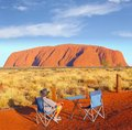 Man camping chair watching sunset Uluru Ayers Rock, Australia Royalty Free Stock Photo