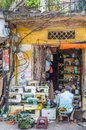 A man can seen repairing sewing machine in Hanoi Old Quarter, capital of Vietnam. Royalty Free Stock Photo