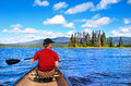 Man canoeing on a lake in british columbia canada the wilderness of Royalty Free Stock Images