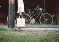 Man with canvas bag and vintage bicycle on background retro filter Royalty Free Stock Images