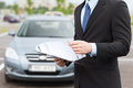 Man with car documents outside transportation and ownership concept Stock Images