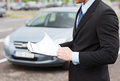 Man with car documents outside transportation and ownership concept Stock Photo