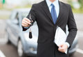 Man with car key outside transportation and ownership concept Royalty Free Stock Image