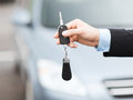 Man with car key outside transportation and ownership concept Stock Photo