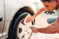 Man with car rims cleaner, carwash Royalty Free Stock Photo
