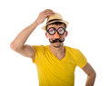 Man with carnival mask and hat isolated over white Stock Images